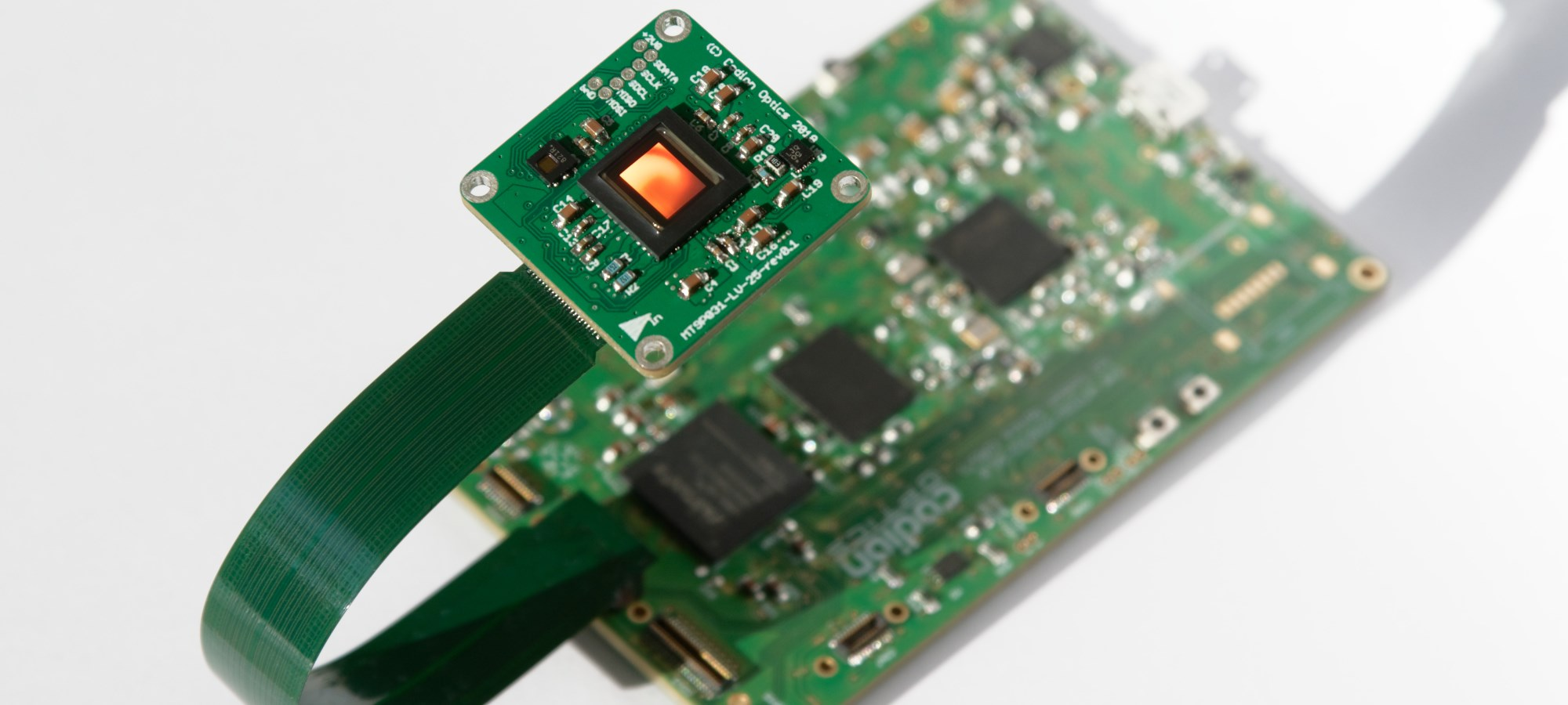 Embedded MCU-FPGA board with attached OnSemi image sensor board